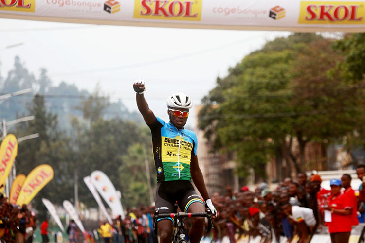 Uwizeyimana Bonaventure punches the air as he crosses the line